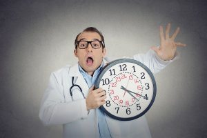 busy overwhelmed doctor who has no time for patients, dysfunctional medical system